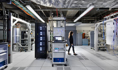 A quantum scientist walks across the IBM Q computation center